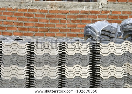 Stack of roof tile waiting place on new house - stock photo