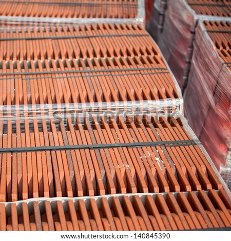 Stack of roofing tiles at factory - stock photo