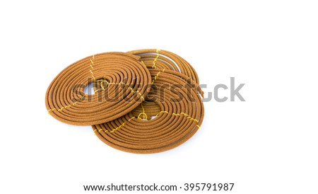Stack of round incense or citronella spiral coil isolated on white. Made from pure ingredients, natural glue with long burn time. It has mild, lasting fragrance. Meditation, worship concept, panorama.