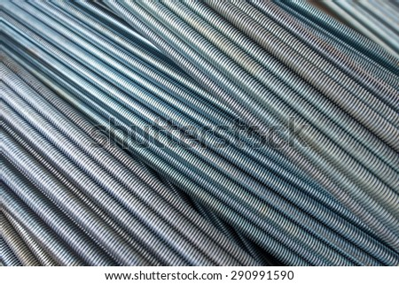 Stack of round steel bar - iron metal rail lines material for industry construction.