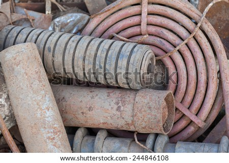 stack of rusted pipes - stock photo