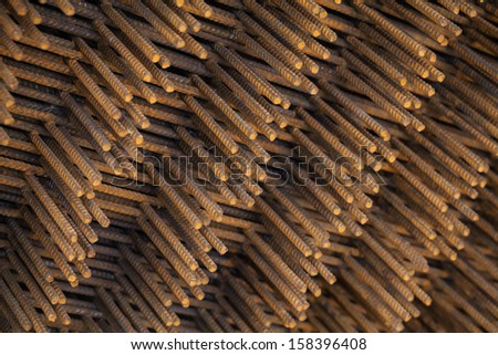 Stack of rusted steel fittings construction elements - stock photo