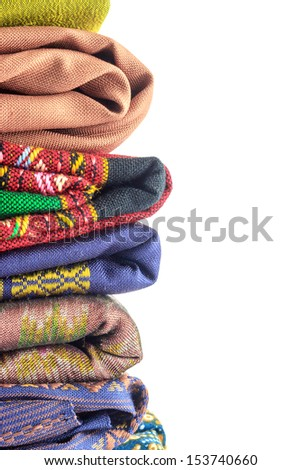 Stack of silk on white background - stock photo