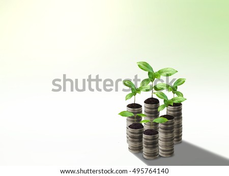 Stack of silver coin and small plant concept growth on soft green background