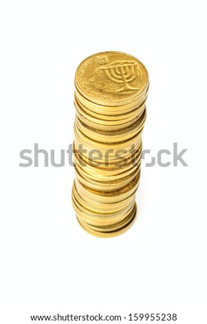 Stack of small coins Israeli in shallow DOF isolated on white background - stock photo
