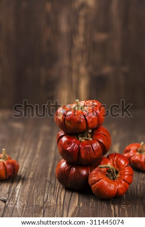 Stack of small orange decorative pumpkins. Halloween or thanksgiving day concept. Vintage style, selective focus - stock photo