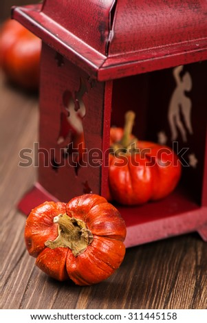 Stack of small orange decorative pumpkins with a card for text. Halloween or thanksgiving day concept. Vintage style, selective focus - stock photo