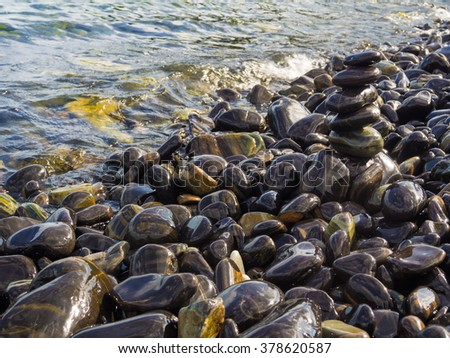 Stack of smooth stones on a seashore, Beach and rock stack