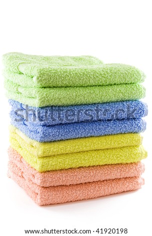 Stack of soft colorful towels - stock photo