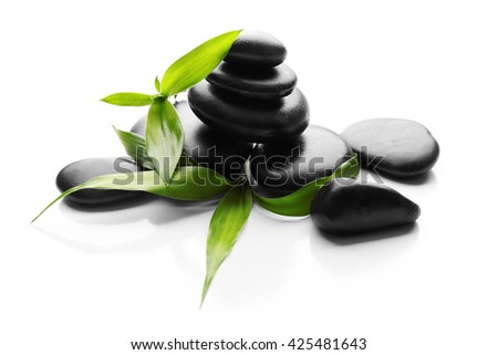 Stack of spa hot stones isolated on white