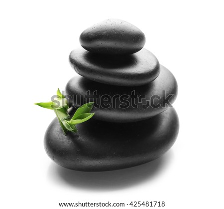 Stack of spa hot stones isolated on white background