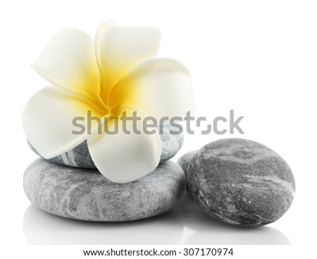Stack of spa stones isolated on white - stock photo
