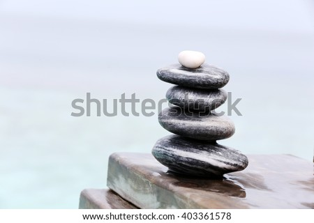Stack of spa stones on wooden wet bridge