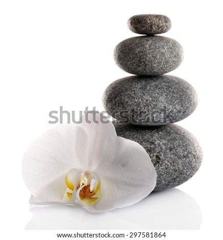 Stack of spa stones with orchid flower isolated on white - stock photo