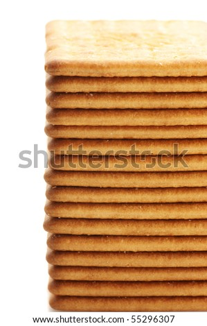 Stack of square crackers close-up on white background.