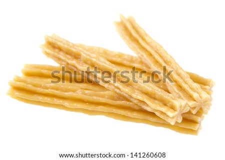 Stack of star shaped dog treats meant for cleaning dogs teeth. - stock photo