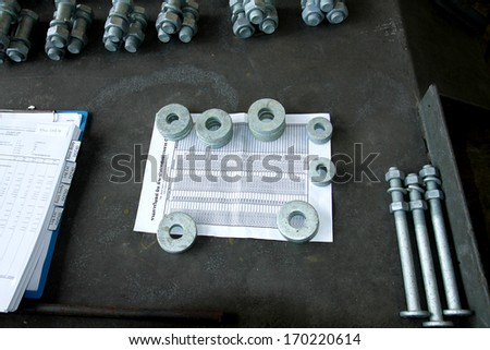 Stack of steel Bolts, nuts & plain washer - stock photo