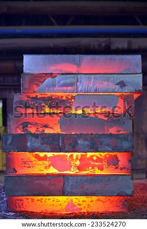 Stack of steel plates inside of plant - stock photo
