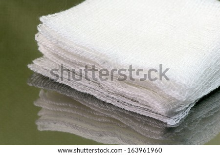 Stack of sterile gauze pad.