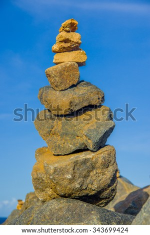 Stack of stones on sea shore, Aruba - stock photo