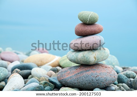 stack of stones on the beach and sea background
