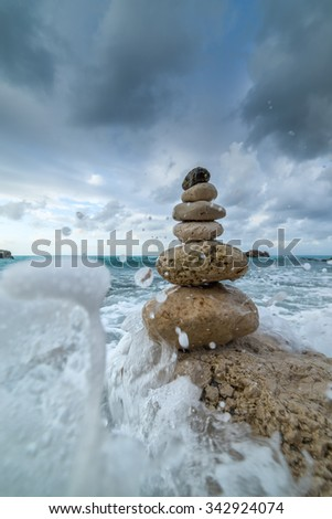 Stack of stones on the beach in Lefkada Greece - stock photo