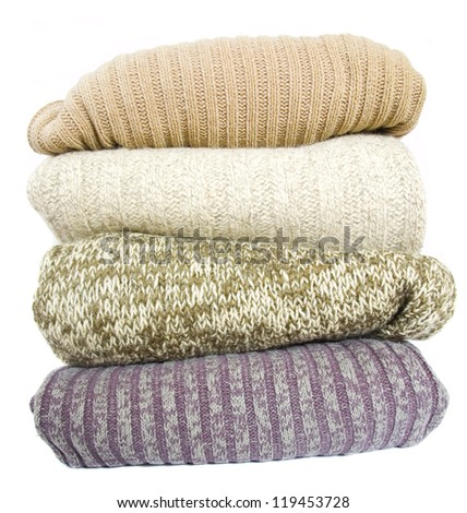 stack of sweaters - stock photo