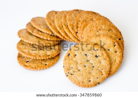 Stack of sweetmeat digestive biscuits isolated on white.