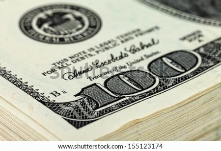 Stack of Ten Thousand Dollar Piles of One Hundred Dollar Bills. Fragment - stock photo