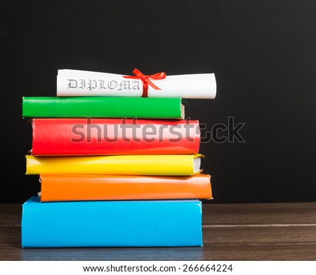 Stack Of Text Books And Graduation Scroll  - stock photo