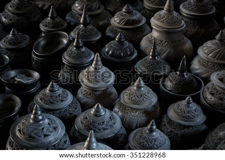 stack of thai clay pottery fine art clay pottery tradition style with beautiful light  - stock photo