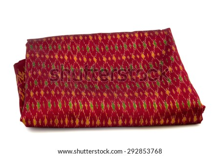 stack of Thai fabric on white background