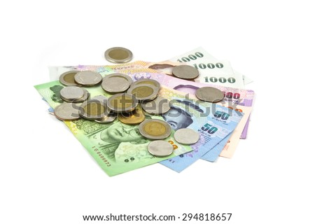 stack of Thai money on white background soft focus