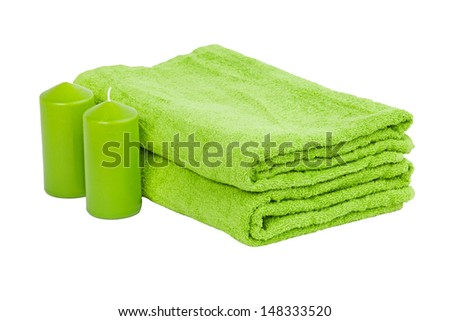 Stack of the multi colored towel with candles