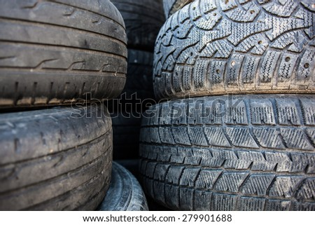 Stack of the old used tire covers. - stock photo