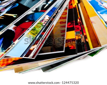 Stack of the photos, isolated on a white background. - stock photo