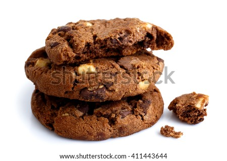 Stack of three dark chocolate chip cookies isolated. One half with crumbs.