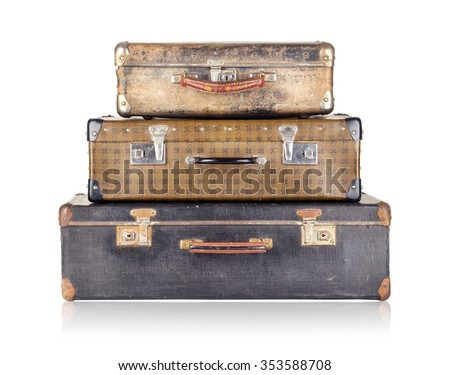 Stack of three old suitcases isolated on white background