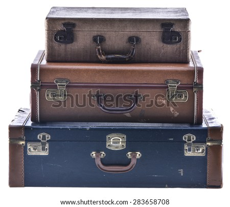 Stack of Three Vintage Suitcases Isolated - stock photo