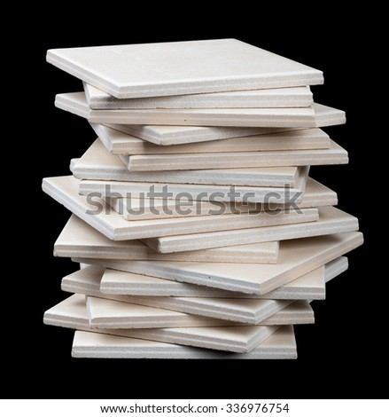 Stack of tiles on black backround, front view
