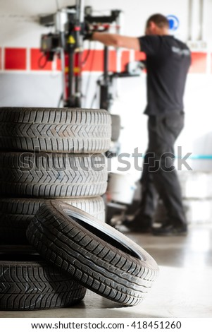stack of tires ready to be installed, winter/summer rotation - stock photo