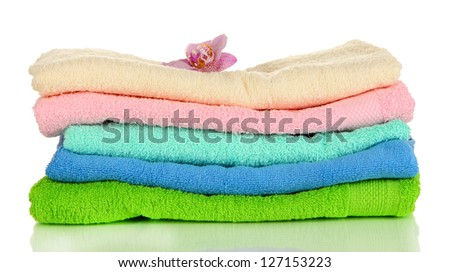 Stack of towels with fragrant flower isolated on white