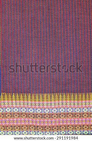 stack of traditional colourful sarong in the shop - stock photo