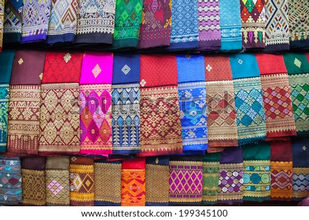 stack of traditional colourful sarong in the shop. for a background - stock photo
