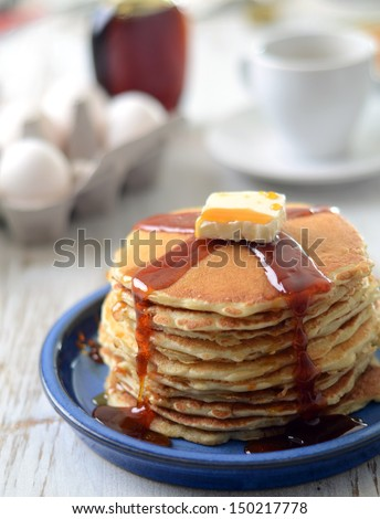 stack of traditional pancakes with syrup and butter  - stock photo