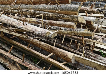 Stack of tree trunks to build a house