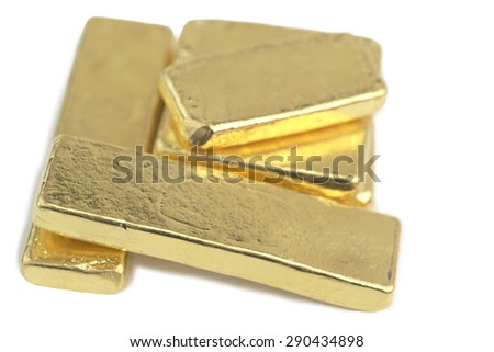 Stack of 4.827 troy ounces gold bars over white table. Each bar known as 10 Baht gold bar which is commonly sold in goldsmith shop. - stock photo