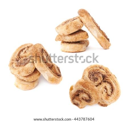 Stack of twisted cookies with cinnamon isolated over the white background - stock photo