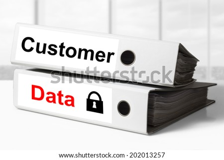 stack of two white office binders customer data security