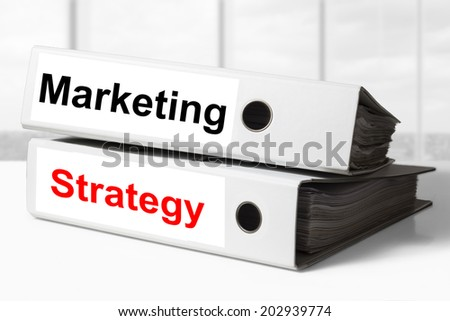 stack of two white office binders marketing strategy - stock photo